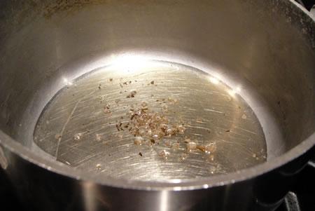 oil salt herbs in pot